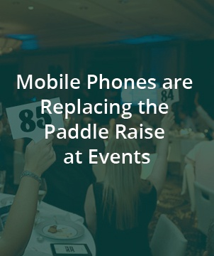Mobile Phones are Replacing the Paddle Raise at Events
